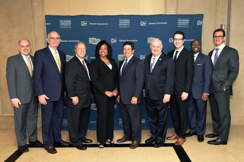 From left: GWAA President Jeremy Gosbee, Gregory Williams, Richard Heideman, Christyl Johnson, GW Board of Trustees Chair Nelson Carbonell, Dr. Knapp, Jay Kaplan, GW Vice President for Development and Alumni Relations Aristide Collins Jr. and Elad Levy.